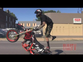 1 leg stunt bike rider riding long wheelies motard stunts moto supermoto wheelie video roc 2014