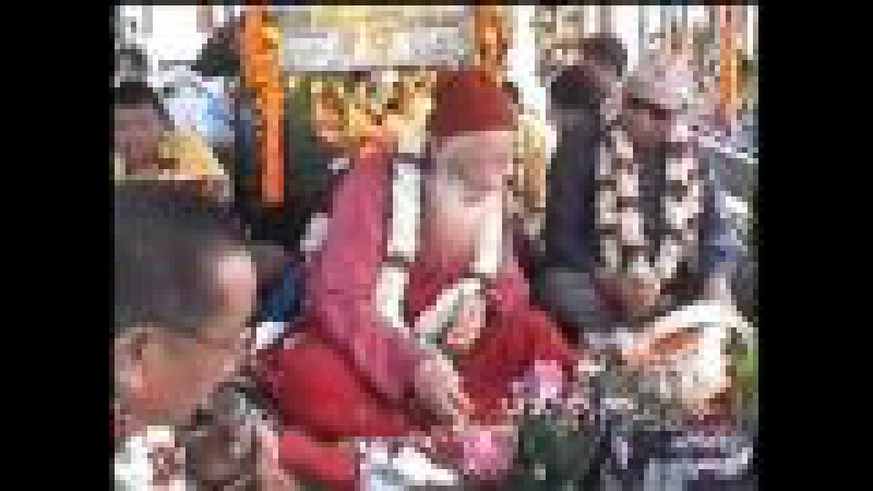 H H Chatral Sangye Dorjee Rinpoche releasing fishes