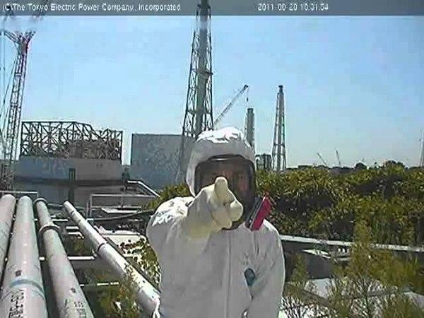 Fukushima Tepco Worker Pointing at Live Feed Camera
