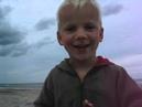 A little boy is dancing on a danish beach