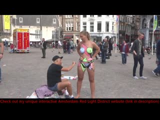 Naked body painting in amsterdams dam square