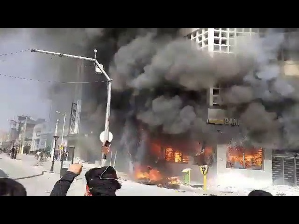 Chants of Death to Khamenei as Iran's Bank Melli burns on Day 2 of IranProtests in Behbahan. Nati