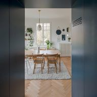 Bureau Brisson Architectes updates Swiss «hybrid» home with blue cabinetry